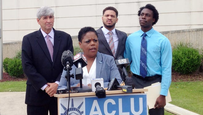 Jennifer Riley-Collins, executive director of the American Civil Liberties Union of Mississippi, center, speaks Monday, May 9, 2016, in Jackson, Miss., about a lawsuit the group filed against the state over House Bill 1523, which will allow workers to cite their own religious objections to same-sex marriage and deny services to citizens. Behind Riley-Collins are attorney Oliver Diaz, left, and plaintiffs in the lawsuit, Nykolas Alford and Stephen Thomas. Alford and Thomas, of Meridian, Miss., are engaged.