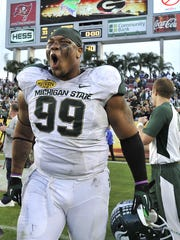 MSU's Jerel Worthy celebrates after the Spartans' 33-30
