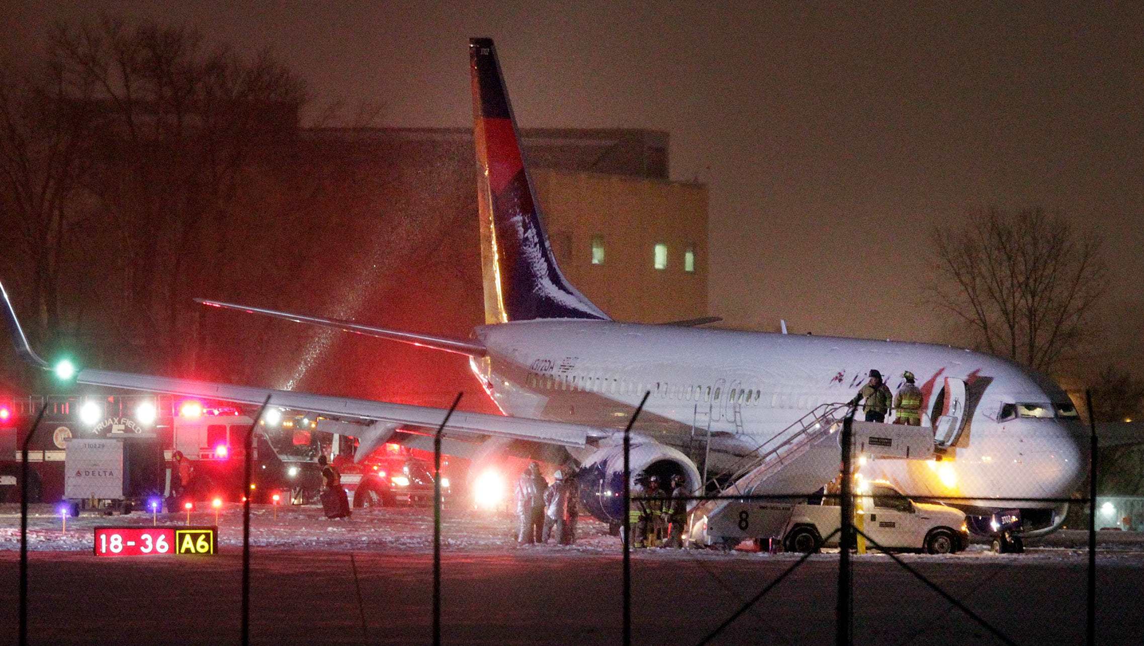 Delta 737 Slides Off Taxiway At Snowy Madison Airport
