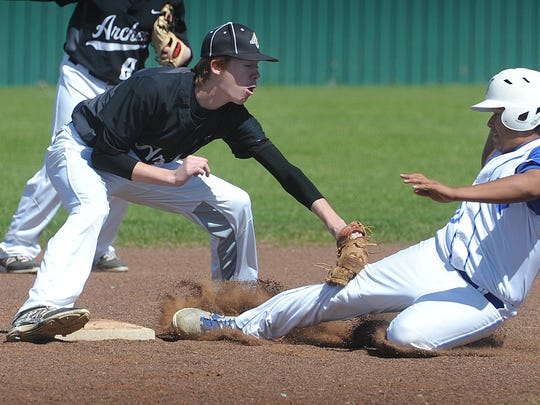 Archer City Wildcats shortstop Morgan Mobley applies the tag to Windthorst Trojans baserunner Fabian Vazquez Thuesday in Archer City. Windthorst defeated Archer City 11-1.