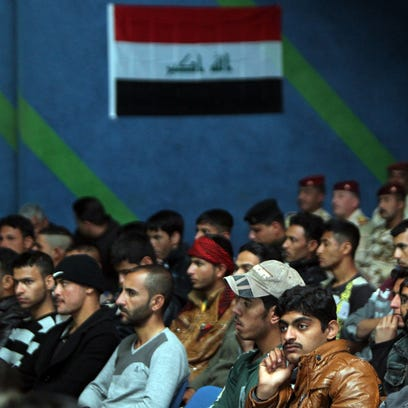Iraqi Sunni volunteers listen during a tribal conference