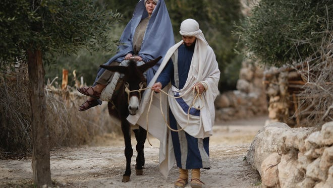 Christian actors portray Joseph and Mary during a re-enactment of a Nativity scene of the journey to Bethlehem as part of Christmas festivities at the Nazareth Village, northern Israel, on Dec. 21, 2017.