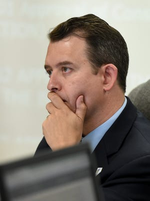 Washoe schools Superintendent Pedro Martinez listens as lawyer Kent Robison speaks at Washoe County Board meeting on August 12, 2014.