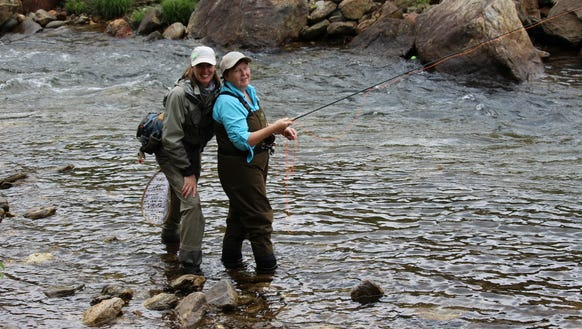 Participants take part in a Casting Carolinas fly-fishing