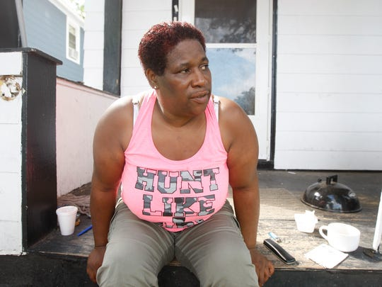 Charlene Collier, who lives on Flint Street, across from the parking lot of the fatal shooting Aug. 19, 2015, talks about hearing gunfire and realizing her daughter knew a victim.
