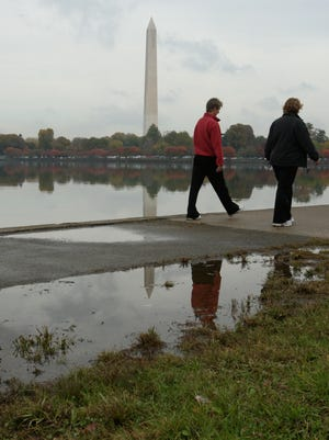 Twice-daily flooding at high tide leaves the ground and walkways around the Tidal Basin in Washington, D.C., sodden, as shown in this photo from 2007