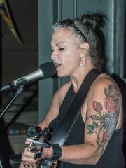 Jilla Webb sings in a solo performance at The Exchange