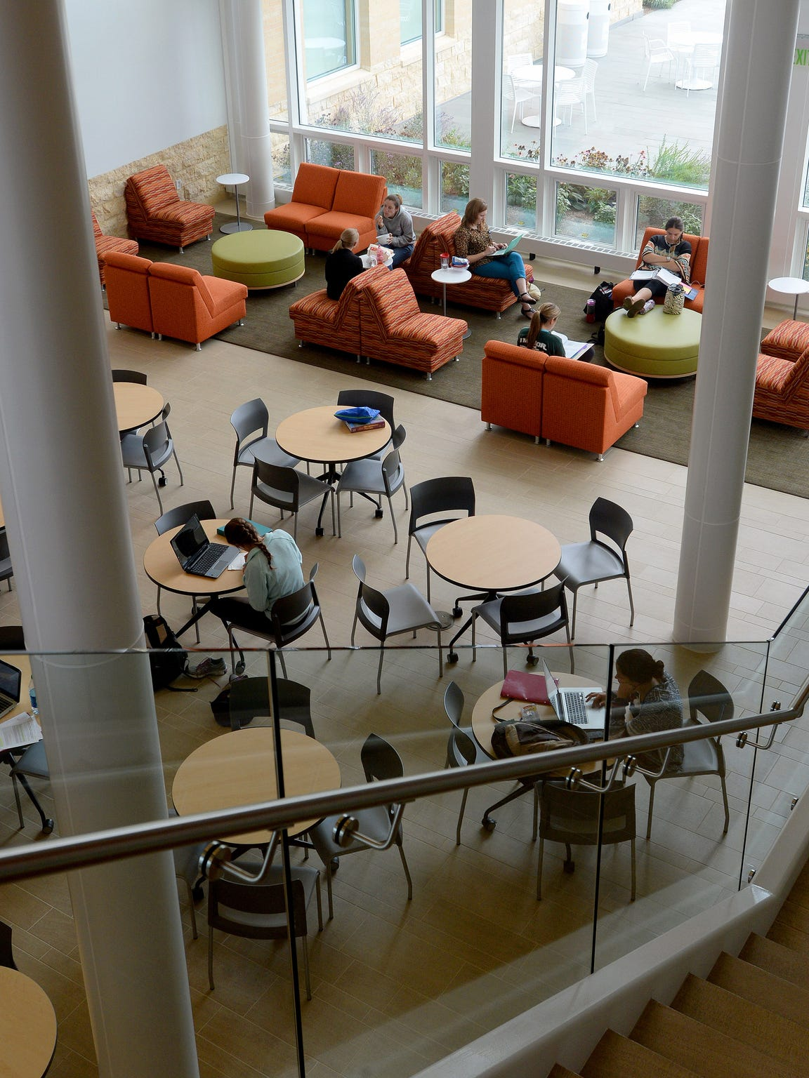 Students sit and study within the atrium at Students