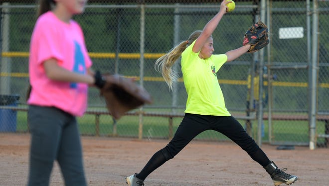 Fairview U12 girls softball team pitchers Kaycie Mullens, right, and McKenna Spicer practice Wednesday, July 27, 2016, before leaving for the Dixie Youth Softball World Series in Myrtle Beach, S.C.