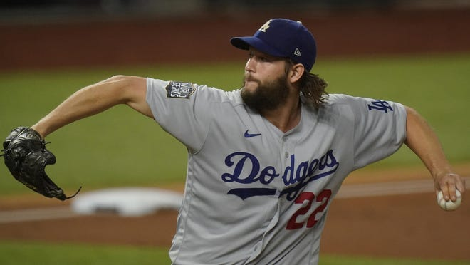Dodgers starter Clayton Kershaw pitches in Game 5 of the World Series on Sunday, in Arlington, Texas.
