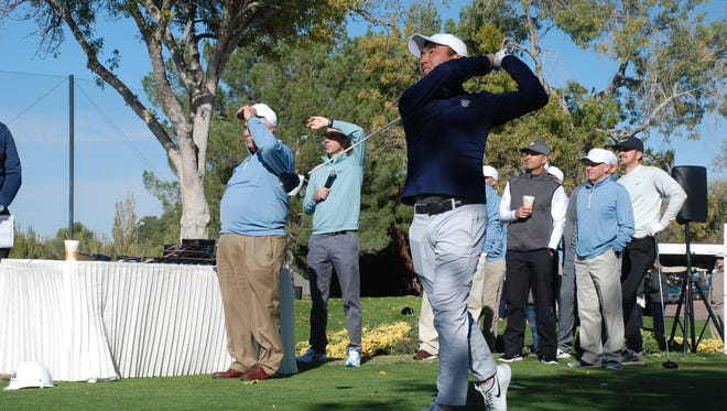 Dough Ghim watches the ball after teeing off at the Sun Bowl Andeavor All-America Golf Classic.