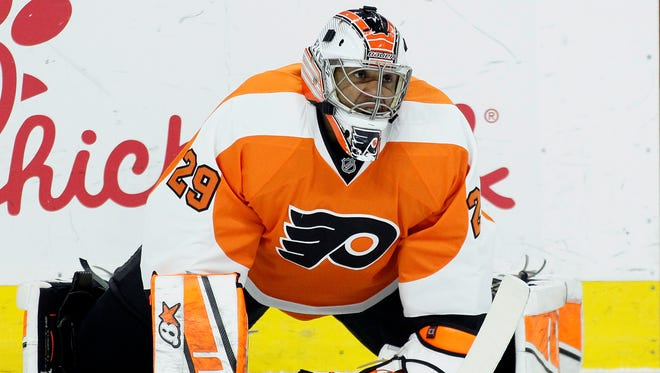 Philadelphia Flyers goalie Ray Emery stretches during warm-up before the start of an NHL hockey game against the Arizona Coyotes, Tuesday, Jan. 27, 2015, in Philadelphia.