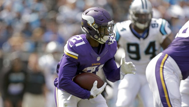 The Minnesota Vikings' Jerick McKinnon (21) looks to turn the corner against the Carolina Panthers during the Sept. 18 game in Charlotte, N.C. The Vikings, who've turned to McKinnon and Matt Asiata with Adrian Peterson likely finished for the season, are last in the NFL in yards rushing.