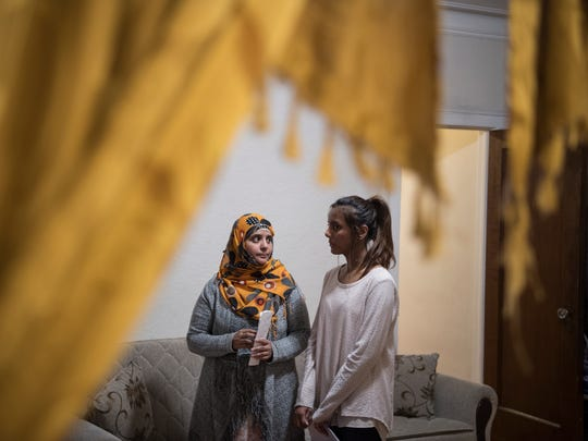 Rojina Akter chose to return to Bangladesh after the deportation of her husband, Amenul Hoque, who was deported to their native Bangladesh in February. The couple have three children, including Evana Akter, 19, right.