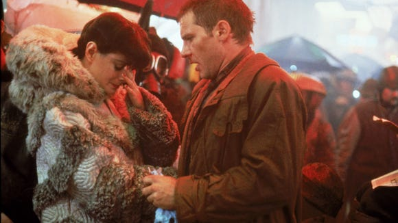 Deckard (Harrison Ford, right) helps out his replicant