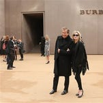 Model Kate Moss and photographer Mario Testino arrive for the Burberry Womenswear Autumn/Winter 2015 show at London Fashion Week in Kensington Gardens, west London Monday.