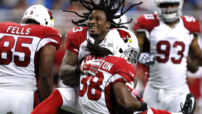 Oct. 11, 2015; Detroit; Arizona Cardinals running back Andre Ellington (38) celebrates with running back Chris Johnson (23) after a touchdown during the fourth quarter against the Detroit Lions at Ford Field.