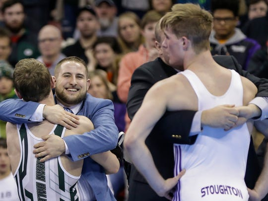 Nathan Hale's Peyton Mocco celebrates with his coach Randy Ferrell after beating Stoughton's Tyler Dow.