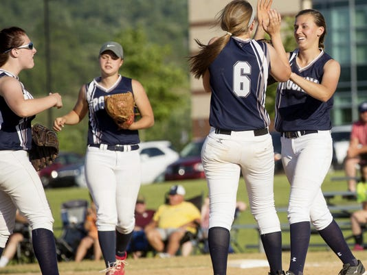 The Chambersburg Trojans celebrate their 5-1 victory over Central York in the opening round of the District 3 softball tournament on Tuesday.