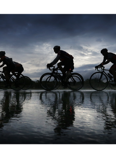 Cyclists endure a downpour Sunday as they ride in the El Paso Holocaust Museum and Study Center?s Tour de Tolerance 100K bike race. Funds raised in the race benefit the museum. MARK LAMBIE/EL PASO TIMES Cyclists endure a downpour Sunday as they ride in the El Paso Holocaust Museum and Study Center's Tour de Tolerance 100K bike race. Funds raised in the race benefit the museum.