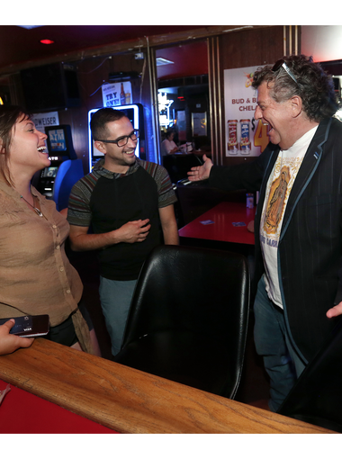 The Tap regular Billy Abraham welcomes first-time visitors Sarah Pugh and Joe Saramento Saturday night at the popular downtown dive.