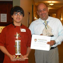 Felician Village has announced that Omar Aldrich-Perez, left, won the Service Excellence Star Award for the month of June.