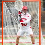 Sophomore goalie Christian Knight, pictured last season against Virginia, has 242 career saves and needs two more to move up to 14th on Cornell's all-time list. The 10th-ranked Big Red is in Providence, R.I., on Saturday to face No. 13 Brown in a crucial Ivy League matchup. Faceoff is slated for 1 p.m.