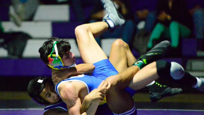 Deshea Pettiford of Fremont Ross wrestles Findlay's Jaden Johnson during the regular season. Pettiford beat Johnson 16-1 by technical fall Saturday at the TRAC Championships.
