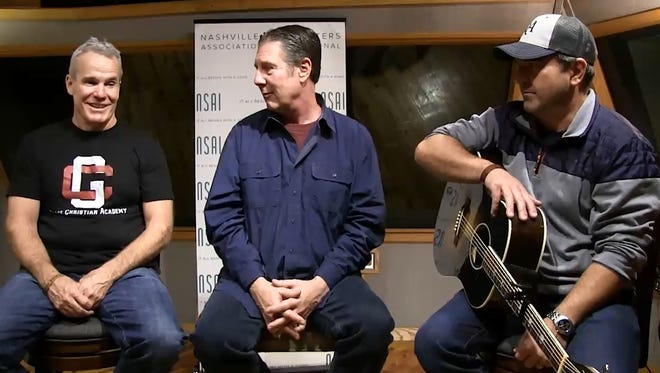 """Casey Beathard, left, talks to Bart Herbison and Dave Turnbull about """"The Boys of Fall."""""""