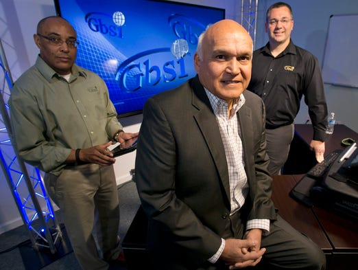 GBSI President and CEO, Randy Ramos, center, with help