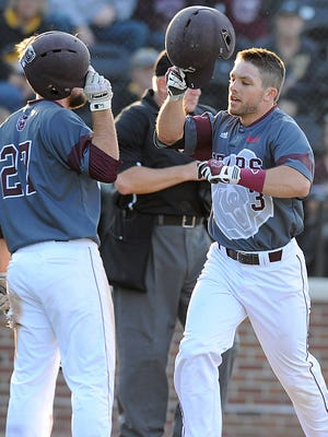 Missouri State's Blake Graham taps helmets with Dylan Becker after Graham hit a home run during the third inning of last Tuesday's game against Missouri in Columbia.