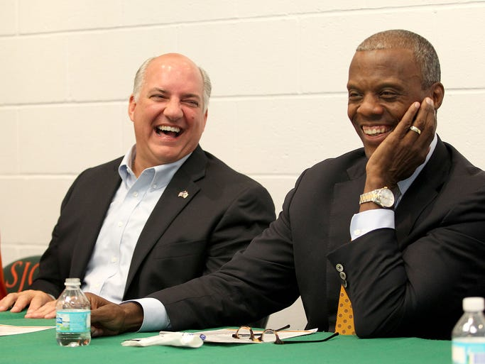 U.S. Congressman Steve Southerland, left, and former U.S. Representative J.C Watts share a laugh as they talked about and toured the FAMU Black Television Network Wednesday morning.