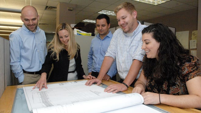 T&M Associates partner Jaclyn Flor (second from left) is shown at the engineering and environmental services firm's office in Middletown with miillennial employees she is mentoring. Employees from left are Jeff Cucinotta, Sandri Lano, Dan Mattson and Jenna Stagliano.