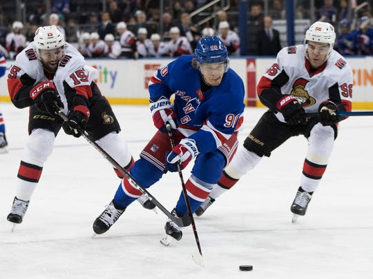 New York Rangers center Vladislav Namestnikov (90) skates against Ottawa Senators left wing Zack Smith (15) and left wing Magnus Paajarvi (56) during the second period of an NHL hockey game, Wednesday, April 3, 2019, at Madison Square Garden in New York. (AP Photo/Mary Altaffer)