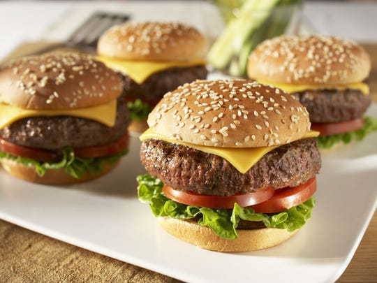 FROM THE COVER: Calypso burgers feature grilled pineapple slices. ABOVE: Classic cheeseburgers draw flavor from steak seasoning blend.