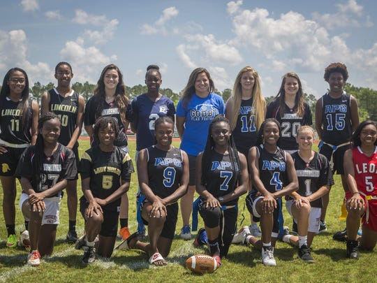 The 2016 All-Big Bend flag football first team. Front row, from left: Kiki Hicks (Chiles), Janae Scott (Florida High), Alexis Nelson (Godby), Mecii Mitchell (Godby), Armarni Williams (Godby), Abbie Townley (Chiles), Jasmine Howard (Leon); Back row, from left: D'Shay Pressley (Lincoln), Kayley Farmer (Lincoln), Olivia Snow (Chiles), Jamiya Bittle (East Gadsden), Coach of the Year Chelsea Parmer (Godby), Player of the Year Shelby Hartley (Godby), Allee Auringer (Chiles), Darrion Denmark (Godby); Not pictured: Ashanti Lamb (FAMU DRS)
