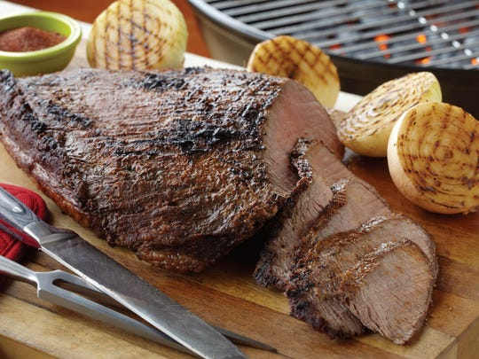 The flavor of beef brisket is enhanced using apple wood chips on the grill.