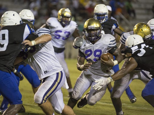 Bainbridge running back Dameon Pierce finds a opening for a run during their preseason game against Godby.