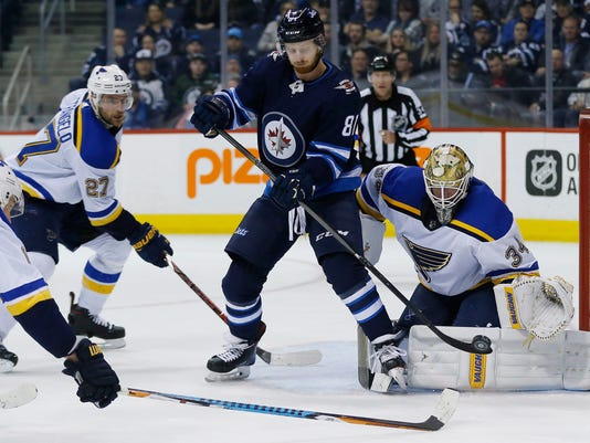 Winnipeg Jets' Kyle Connor (81) attempts to tip the puck past St. Louis Blues goaltender Jake Allen (34) as Alex Pietrangelo (27) defends during the second period of an NHL hockey game Friday, Feb. 9, 2018, in Winnipeg, Manitoba. (John Woods/The Canadian Press via AP)