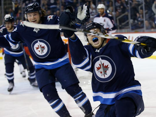 APTOPIX_Blue_Jackets_Jets_Hockey_46821.jpg