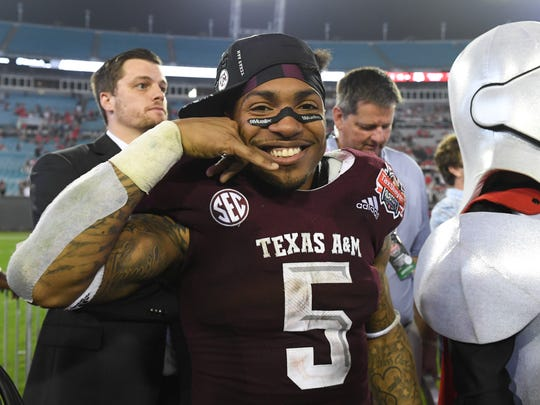 Dec 31, 2018; Jacksonville, FL, USA; Texas A&M Aggies running back Trayveon Williams (5) poses on the field after defeating the North Carolina State Wolfpack at TIAA Bank Field. Mandatory Credit: Adam Hagy-USA TODAY Sports