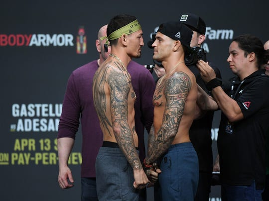 Apr 12, 2019; Atlanta, GA, USA; Max Holloway (left) and Dustin Poirier (right) during weigh ins for UFC 236 at State Farm Arena. Mandatory Credit: Adam Hagy-USA TODAY Sports