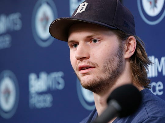 In this April 22, 2019, file photo, Winnipeg Jets' Jacob Trouba speaks to the media at their closing press conference after losing in the first round of the NHL playoffs, in Winnipeg, Manitoba. (John Woods/The Canadian Press via AP, File)