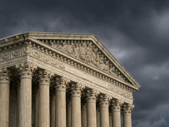 FILE - In this June 20, 2019 file photo, The Supreme Court is seen under stormy skies in Washington. Both sides of the abortion debate are waiting to see if the Supreme Court adds new disputes over state abortion regulations to its election-year docket. The court is expected to announce Friday new cases it will consider in the term that begins next week. (AP Photo/J. Scott Applewhite)
