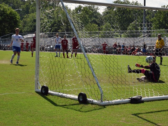 Robert E. Lee's Caleb King rips a penalty kick past Stonewall Jackson keeper William McCourt for the game-ending goal in the Leemen's 8-0 victory over the Generals in the Shenandoah District boys soccer tournament championship game on Friday, May 25, 2018, at Winston-Wine Memorial Stadium in Staunton, Va.