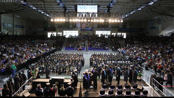 A high school graduation inside Alico Arena on FGCU's campus.