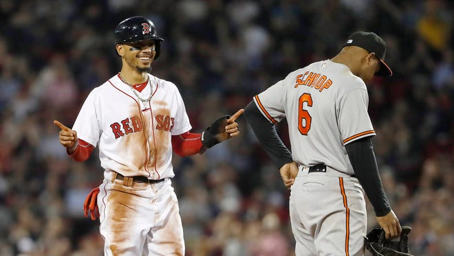 Red Sox right fielder Mookie Betts smiles after stealing second base against the Orioles.