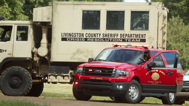 The Livingston County Sheriff's Crisis Resolution Team arrives on scene just before noon Wednesday, Sept. 6, 2017, responding to a man negotiating with police in Putnam Township near the intersection of Pingree and Spears roads. The man was taken into protective custody and is receiving professional assistance.