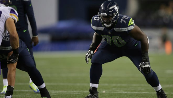 Seattle Seahawks offensive guard Rees Odhiambo waits for the snap during an NFL football preseason game against the Minnesota Vikings, Friday, Aug. 18, 2017, in Seattle.