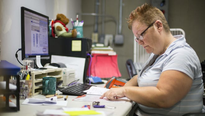 Heather Schmidt works at Quality Resource Group in Urbandale on Aug. 5, 2015. Schmidt went through Project Iowa in 2014. Before that, she made less than $10 an hour. Now, she works (part-time) at QRG, but makes much better money and no longer lives paycheck to paycheck.